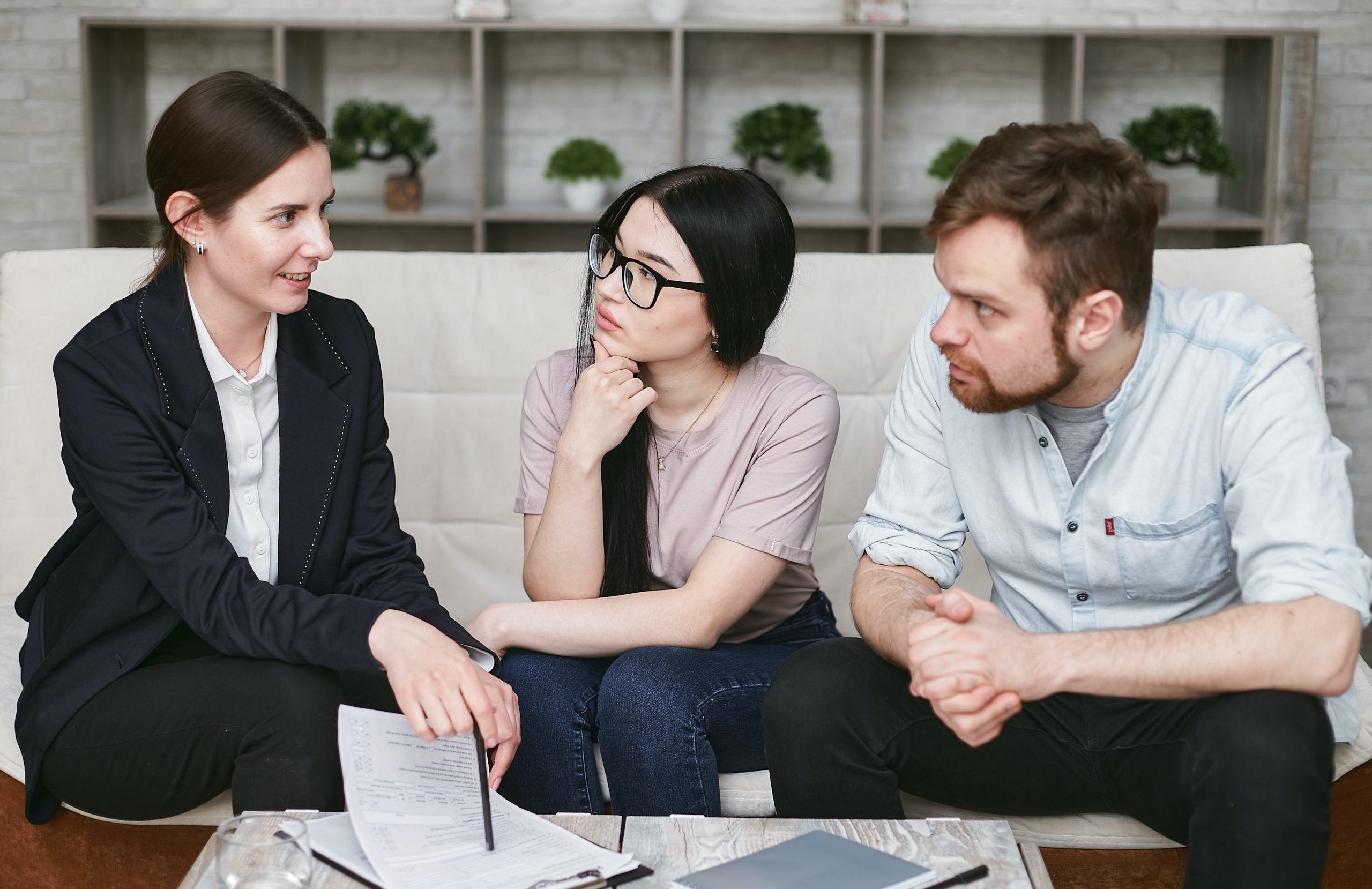 financial planner working with young couple